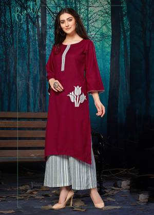 Simple and elegant Looking Readymade Plazzo Set Is Here In Maroon Colored Kurti Paired With Grey Colored Lining Plazzo. Its Top IS Fabricated on Rayon Beautified With Applique Work Paired With Khadi Cotton Fabricated Plazzo.