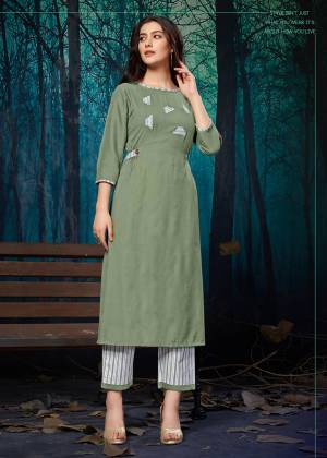 For Your Semi-Casuals, Grab This Readymade Plazzo Set In Mint Green Colored Kurti Paired With White Colored Plazzo. Its Top Is Fabricated On Rayon Paired With Khadi Cotton Bottom. It Is Beautified With Pretty Elegant Applique Work.