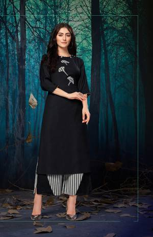 For A Bold And Beautiful Look, Grab This Readymade pair Or plazzo And Kurti In Black And White Color. Its Top IS Rayon Based Paired With Khadi Cotton Fabricated Plazzo. Buy This Pretty Pair Now.