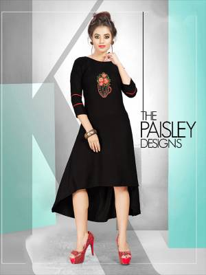 For A Bold And Beautiful Look, Grab This Readymade Designer Kurti In Black Color Fabricated On Rayon. It Is Beautified With Pretty Subtle Work. Buy This Kurti Now.
