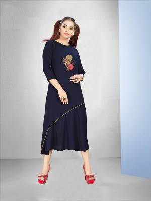 Enhance Your Personality Wearing This Designer Readymade Kurti In Navy Blue Color Fabricated On Rayon. It Is Beautified With Work Making It More Attractive.