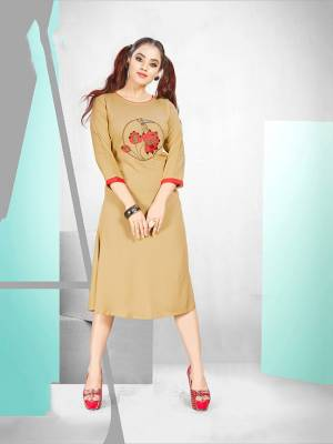 Simple And elegant Looking Readymade Designer Kurti Is Here For Your Semi-Casuals In Beige Color. It Is Fabricated Rayon Which IS Soft Towards Skin And Ensures Superb Comfort All Day Long.