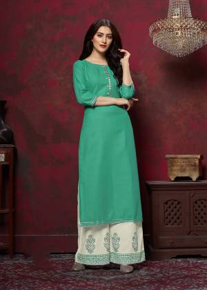 Grab This Very Pretty Designer Readymade Plazzo Set In Sea Green Colored Top Paired With Off-White Colored Bottom. This Kurti And Plazzo Are Fabricated On Cotton And Available In All Regular Sizes. Buy This Pretty Pair Now.