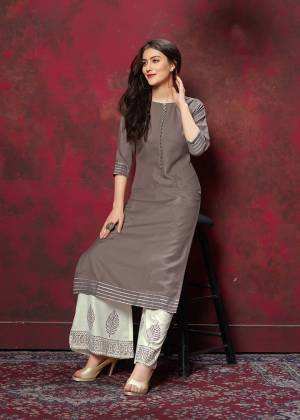 Grab This Very Pretty Designer Readymade Plazzo Set In Grey Colored Top Paired With Off-White Colored Bottom. This Kurti And Plazzo Are Fabricated On Cotton And Available In All Regular Sizes. Buy This Pretty Pair Now.