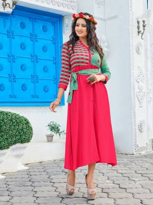 Add This Very Pretty Designer Patterned Readymade Kurti To Your Wardrobe In Dark Pink Color Fabricated on Rayon. It Is Light In Weight And Easy To Carry All Day Long.
