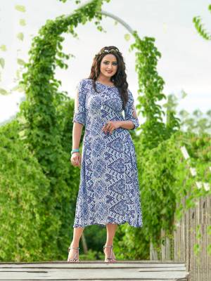 Simple And Elegant Looking Designer Readymade Kurti Is Here In Blue And White Color Fabricated On Rayon. It Is Soft Towards Skin And Easy To Carry All Day Long.