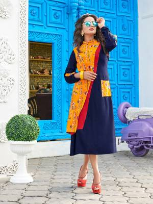For Your Semi-Casuals, Grab This Readymade Kurti In Navy Blue Color Fabricated On Rayon. Its Unique Pattern And Color Pallete Will Earn You Lots Of Compliments From Onlookers.