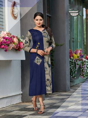 Add This Very Pretty Designer Patterned Readymade Kurti To Your Wardrobe In Blue And Grey Color Fabricated on Rayon. It Is Light In Weight And Easy To Carry All Day Long.