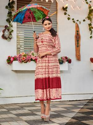 Simple And Elegant Looking Designer Readymade Kurti Is Here In Off-White And Red Color Fabricated On Rayon. It Is Soft Towards Skin And Easy To Carry All Day Long.