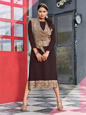 For Your Semi-Casuals, Grab This Readymade Kurti In Dark Brown Color Fabricated On Rayon. Its Unique Pattern And Color Pallete Will Earn You Lots Of Compliments From Onlookers.