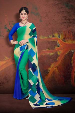 For Your Casual Wear, Grab This Pretty Printed Saree In Sea Green And Royal Blue Color Paired With Royal Blue Colored Blouse. This Saree And Blouse are Fabricated On Georgette Which Ensures Superb Comfort All Day Long.