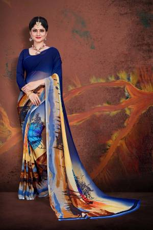Simple And Elegant Saree For Your Casuals Or Semi-Casuals Is Here In Navy Blue And Multi Color Paired With Navy Blue Colored Blouse. This Saree And Blouse Are Fabricated On Georgette Beautified With Prints.