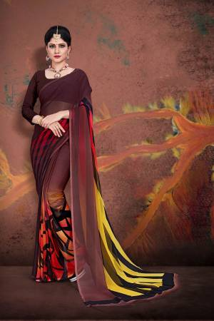 Beat The Heat This Summer Wearing This Light Weight Printed Saree In Brown Color Paired With Brown Colored Blouse. This Saree And Blouse Are Fabricated On Georgette. Buy Now.