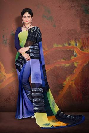 Bright And Appealing Shaded Saree Is Here In Blue Color Paired With Dark Blue Colored Blouse. This Saree and Blouse Are Georgette Based Which Is Soft Towards Skin And Easy To Carry All Day Long.
