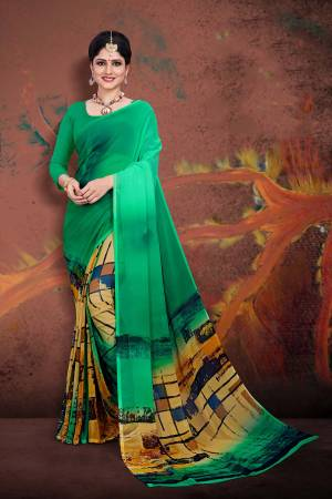 Beat The Heat This Summer Wearing This Light Weight Printed Saree In Green Color Paired With GreenColored Blouse. This Saree And Blouse Are Fabricated On Georgette. Buy Now.