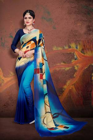 For Your Casual Wear, Grab This Pretty Printed Saree In Multi And Navy Blue Color Paired With Navy Blue Colored Blouse. This Saree And Blouse are Fabricated On Georgette Which Ensures Superb Comfort All Day Long.
