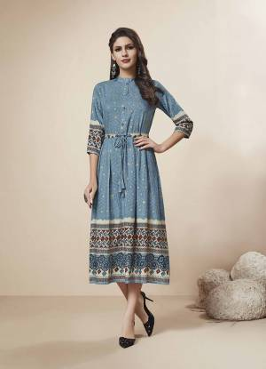 Grab This Very Pretty Readymade Kurti In Blue Color Fabricated On Rayon. This Pretty Kurti Is Beautified With Prints And Foil Print All Over.