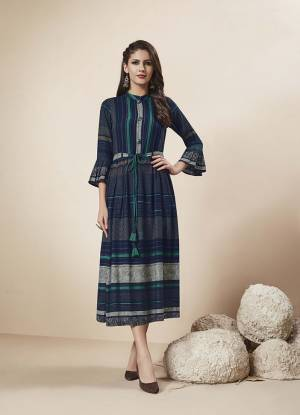 Enhance Your Personality In This Designer Readymade Kurti In Navy Blue Color Fabricated On Rayon. This Kurti Is Light In Weight And Easy To Carry All Day Long.
