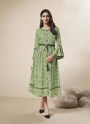 Look Pretty In This Lovely Designer Readymade Kurti In Light Green Color Fabricated On Rayon. This Kurti IS Beautified With Prints And Also Has Foil Print All Over It.