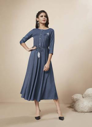 You Will Definitely Earn Lots Of Compliments Wearing This Rich And Elegant Looking Designer Readymade Kurti In Dark Blue Color Fabricated On Rayon Denim. It Is Beautified With Pretty Thread And Stone Work.