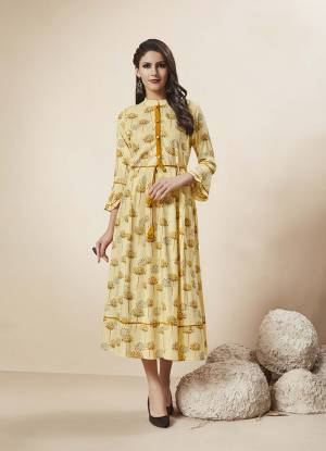 Simple And Elegant Looking Readymade Designer Kurti Is Here In Light Yellow Color Fabricated On Rayon. This Kurti Is Beautified With Prints And Also It Is Light In Weight And Easy To Carry All Day Long.