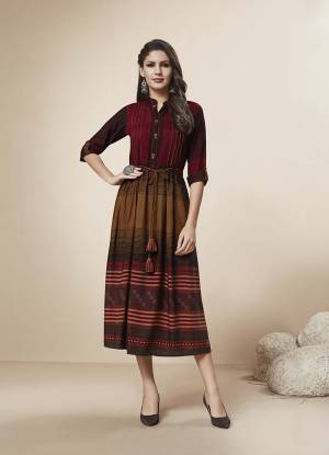 For A Rich And Elegant Look, Grab This Pretty Simple Readymade Kurti In Maroon And Brown Color Fabricated On Rayon. This Kurti Is Beautified With Lining Prints. Also It Is Available In All Sizes, Choose As Per Your Comfort.