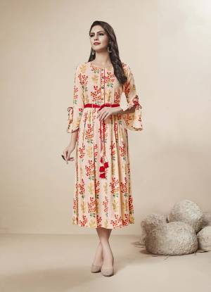 Pretty In Peach, A Must Have Shade In Every Womens Wardrobe Is Here With This Readymade Kurti In Light Peach Color Fabricated On Rayon. It Is Beautified With Floral Prints And Foil Print All Over It.