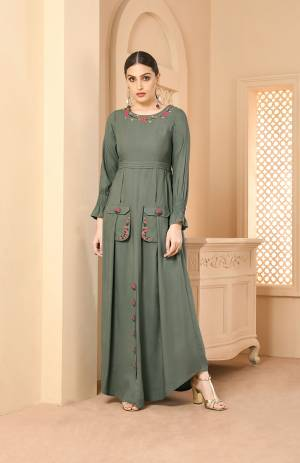 New And Unique Shade Is Here With This Designer Readymade Long Kurti In Teal Grey Color Fabricated On Rayon. It IS Beautified With Contrasting Thread Work Which Gives A Pretty Look To It.