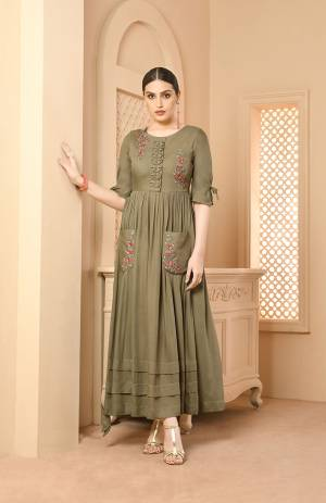 You Will Definitely Earn Lots Of Compliments Wearing This Designer Readymade Long Kurti In Light Olive Green Color Fabricated On Rayon. Its Fabric Is Soft Towards Skin And Easy To Carry All Day Long.