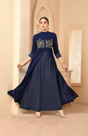 Here Is A Very Beautiful Patterned Designer Readymade Long Kurti In Navy Blue Color Fabricated On Rayon. This Long Kurti Is Light In Weight And Soft Towards Skin Which Is Easy To Carry All Day Long.