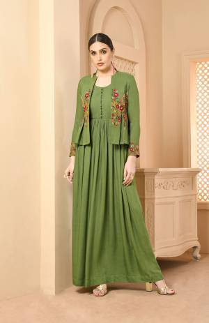 Grab This Jacket Patterned Designer Readymade Long Kurti In Green Color Fabricated On Rayon. Its Pretty Jacket Is Beautified With Contrasting Thread Work Giving It An Attractive Look. Buy Now.