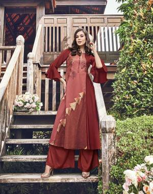 Add This Very Pretty Designer Kurti To Your Wardrobe In Maroon Color Fabricated On Modal Jacquard Which Is Soft Towards Skin And Easy To Carry All Day Long.