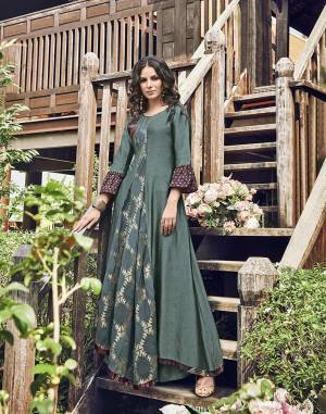 New Shade Is Here With This Designer Readymade Long Kurti In Teal Blue Color. This Pretty Kurti Is Fabricated On Modal Jacquard Beautified With Prints And Thread Work.