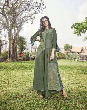 Get Ready For The Upcoming Festive And Wedding Season With This Designer Readymade Kurti In Olive Green Color Fabricated On Modal Jacquard. This Kurti Is Beautified With Prints And Thread Work. Buy Now.