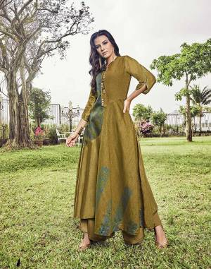 Grab This Designer Piece In Pear Green Color For The Upcoming Festive And Wedding Season. This Readymade Long Kurti Is Fabricated On Modal Jacquard Beautified With Unique Pattern, Prints And Thread Work.