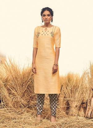 Celebrate This Festive Season With Beauty And Comfort Wearing This Designer Readymade Pair Of Kurti And Pant In Light Yellow And Grey Color Respectively. Both The Top And Bottom Are Viscose Silk Based. It Is Light In Weight And Easy To Carry All Day Long.