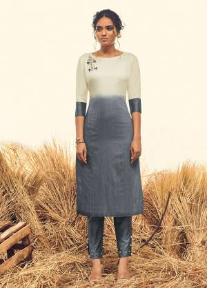 Here Is A Very Beautiful Shaded Kurti In Dark Grey And White Color Paired With Dark Grey Colored Pants. This Top And Bottom Are Fabricated Banarasi Viscose Silk Which Also Gives A Rich Look To Your Personality.