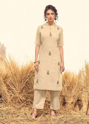 Flaunt Your Rich And Elegant Taste With This Readymade Designer Pair Of Kurti And Pant. This Pair Is Fabricated On Visose silk Beautified With Hand Work Motifs On Top. Its Rich Fabric And Color Will Earn You Lots Of Compliments From Onlookers.