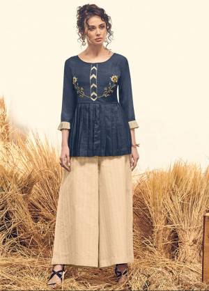 For The Latest Trend And Style, Grab This Readymade Indo-Western Pair In Navy Blue Colored Top Paired With Cream Colored Bottom, Its Top Is Fabricated On Viscose Silk And Bottom IS Khadi Cotton Based, Which Ensures Superb Comfort All Day Long.