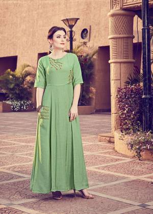 Get For The Upcoming Festive Season With This Readymade Kurti In Green Color. This Pretty Kurti Is Beautified With Minimal Hand Work And Available In All Regular Sizes.