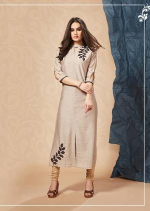 For Your Semi-Casuals Or Social Gatherings, Grab This Designer Readymade Kurti In Beige Color. It Has Pretty Attractive Hand Work Which Gives A Rich And Elegant Look Over All. Buy Now.
