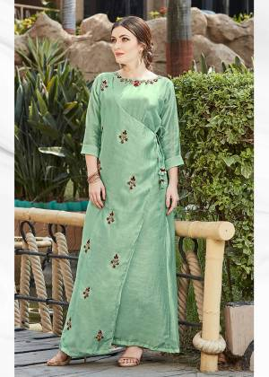 Here Is A Very Beautiful Designer Readymade Kurti In Mint Green Color. It Has Very Pretty And Trendy Color Beautified With Hand Work. Also It IS Light In Weight And Ensures Superb Comfort All Day Long.