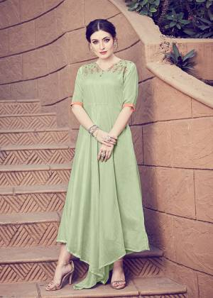 Get For The Upcoming Festive Season With This Readymade Kurti In Pastel Green Color. This Pretty Kurti Is Beautified With Minimal Hand Work And Available In All Regular Sizes.