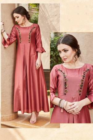 For Your Semi-Casuals Or Social Gatherings, Grab This Designer Readymade Kurti In Maroon Color. It Has Pretty Attractive Hand Work Which Gives A Rich And Elegant Look Over All. Buy Now.