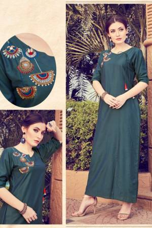 Add This Pretty Readymade Kurti To your Wardrobe In Dark Teal Blue Color. It Is Beautified With Unique Pattern And Attractive Embroidery Which Will Earn You Lots Of Compliments From Onlookers.