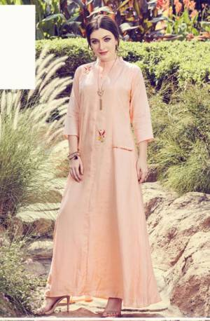 Get For The Upcoming Festive Season With This Readymade Kurti In Light Peach Color. This Pretty Kurti Is Beautified With Minimal Hand Work And Available In All Regular Sizes.
