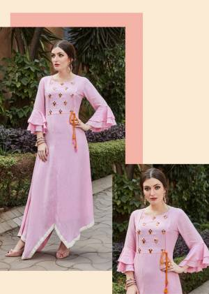 For Your Semi-Casuals Or Social Gatherings, Grab This Designer Readymade Kurti In Pink Color. It Has Pretty Attractive Hand Work Which Gives A Rich And Elegant Look Over All. Buy Now.