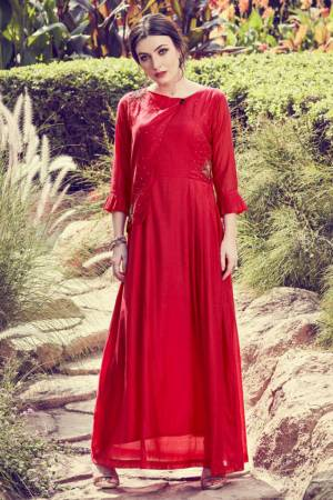 Here Is A Very Beautiful Designer Readymade Kurti In Red Color. It Has Very Pretty And Trendy Color Beautified With Hand Work. Also It IS Light In Weight And Ensures Superb Comfort All Day Long.