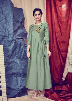 Get For The Upcoming Festive Season With This Readymade Kurti In Mint Green Color. This Pretty Kurti Is Beautified With Minimal Hand Work And Available In All Regular Sizes.