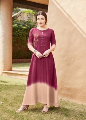 For Your Semi-Casuals Or Social Gatherings, Grab This Designer Readymade Kurti In Maroon & Beige Color. It Has Pretty Attractive Hand Work Which Gives A Rich And Elegant Look Over All. Buy Now.